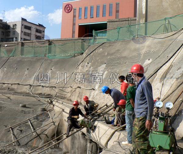 重庆中国银行办公房地基处理中基坑支护工程中锚索张拉